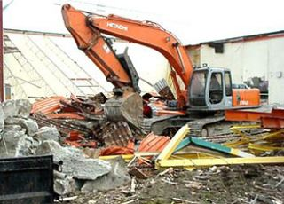 Excavator in rubble front view